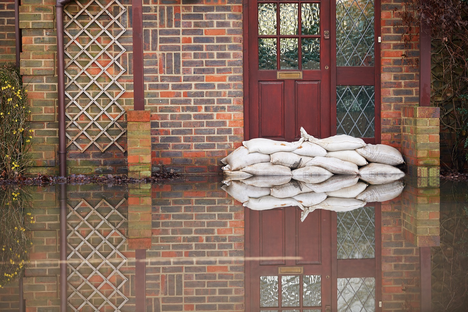 how much renters insurance Naborly Sandbags Outside Front Door Of Flooded House
