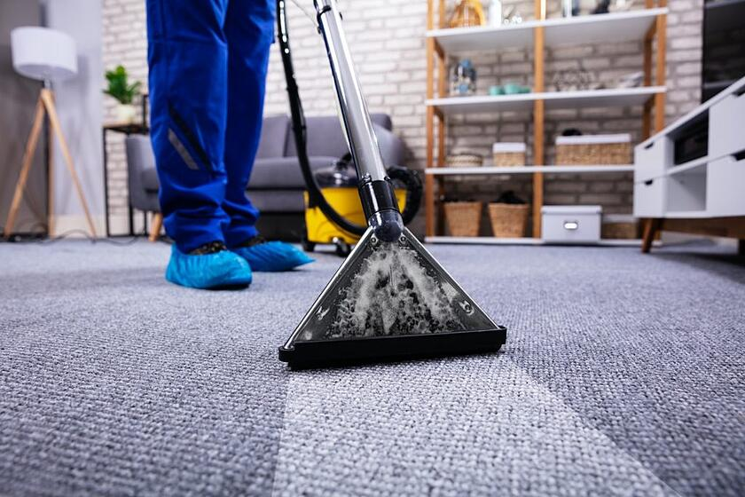 tenant cleaning carpets for inspection